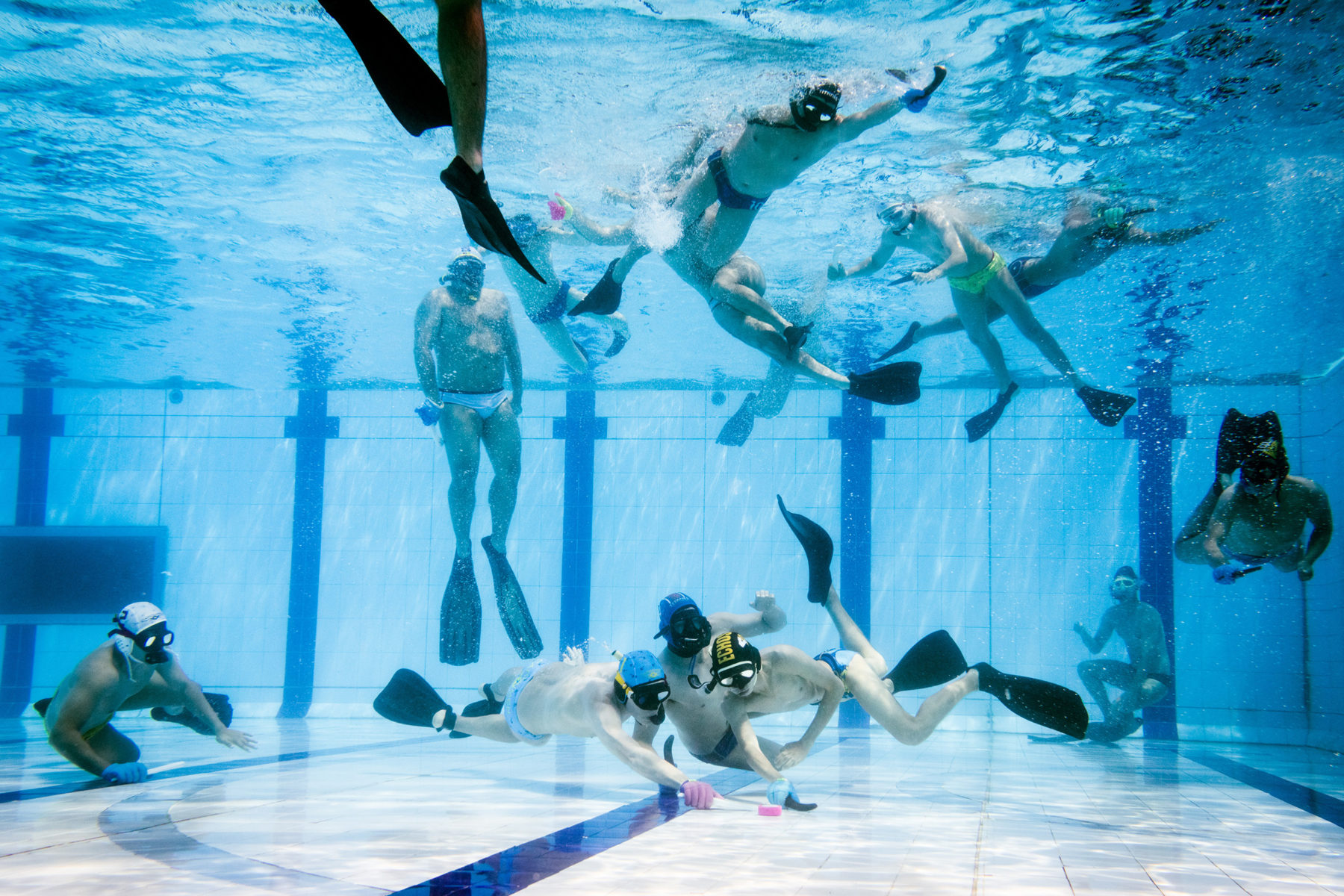 The players swim on the surface, watch the game, and dive down as soon as they see a possibility to intervene.
