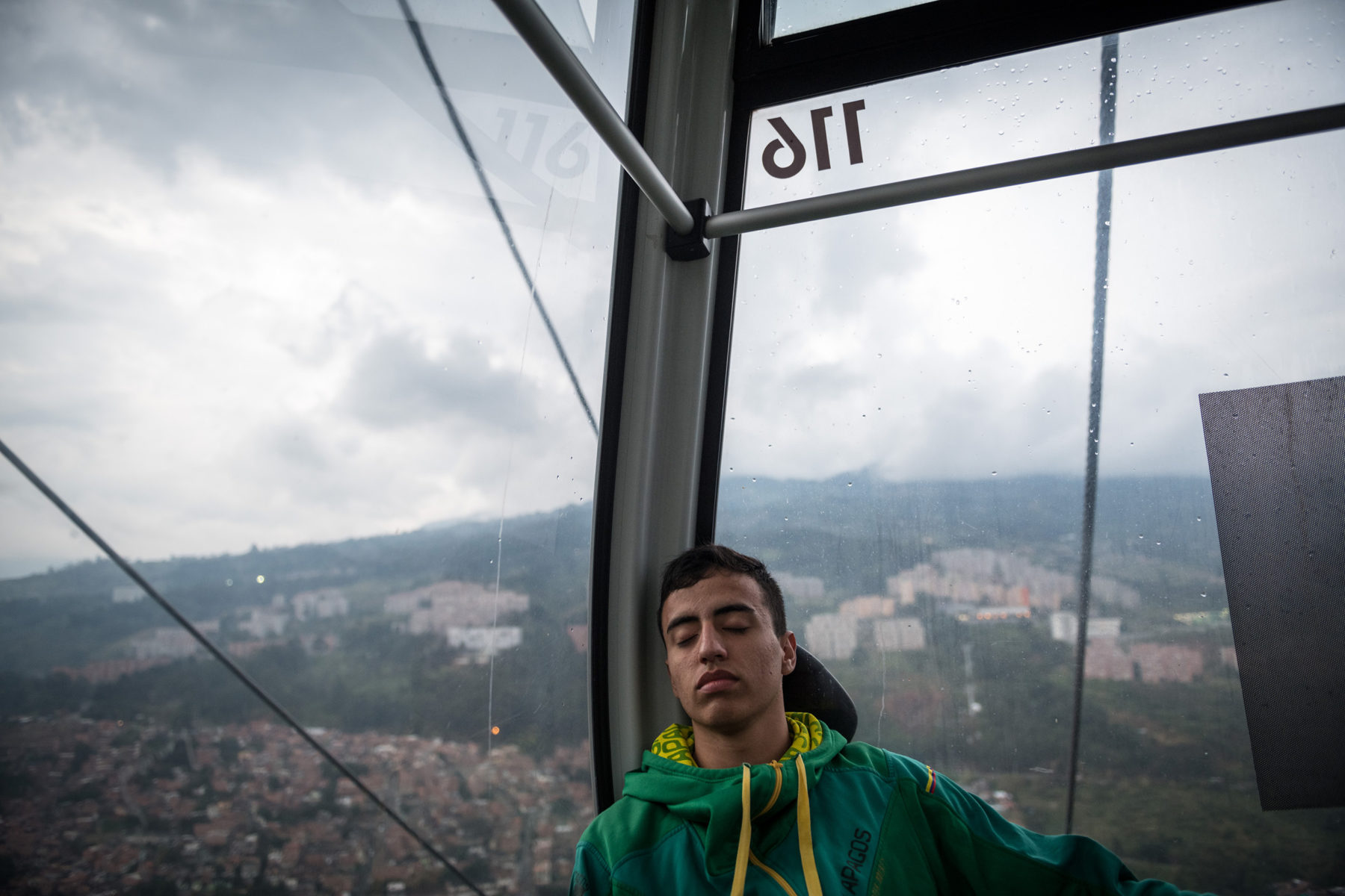 After the long matchday, Daniel takes the cable car home. The city of Medellín has started building cable car lines with the poorest districts in order to shorten the distances to the center. Daniel needs 30 minutes to commute via the cable car and Metro and 50 minutes via direct bus.